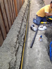 a Vacaville irrigation repair tech is installing a new sprinkler system